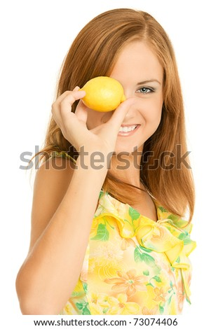 Close-up of Young woman holding half cut sour lemon