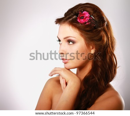 Close-up of  young woman looking at copyspace isolated