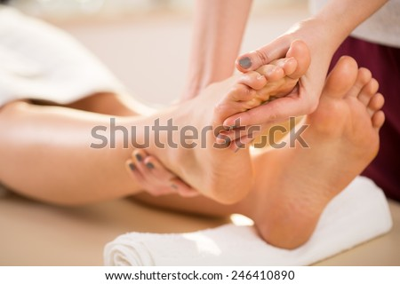 Close-up of young woman's foot massage - stock photo