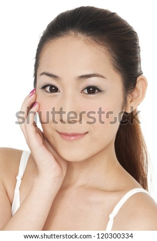 close up of young woman smile face and hand touch her face