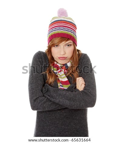 Close up of young woman with winter cap isoalted on white background - stock photo