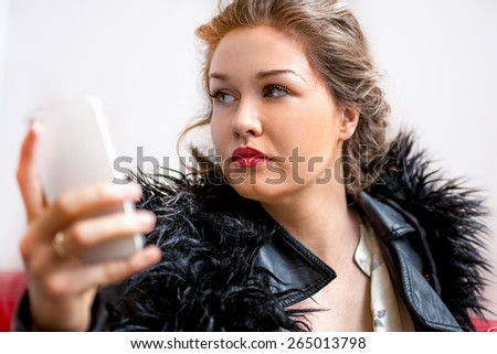 Close up of young women touching and browsing her smart phone. - stock photo