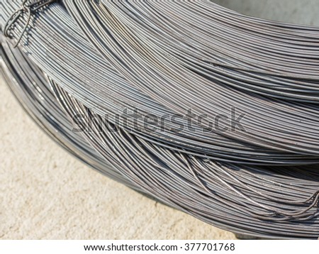close up ofmetal wire on concrete, preparing to build a house
