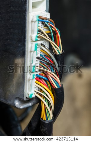 Close up old and dirty car automotive wiring, multi color wire cable with plug - stock photo