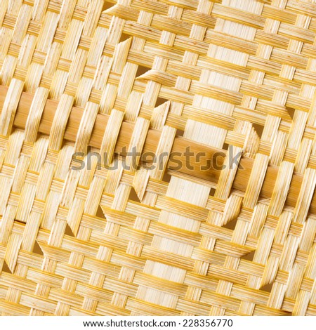 Close up old and dirty natural color weaved bamboo texture