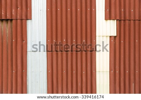 Close up old and rusty corrugated metal sheet wall texture background - stock photo