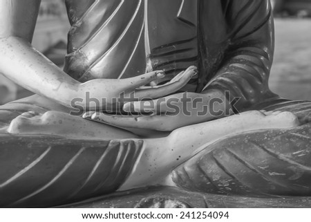 close up old buddha hand to meditation on public temple. - stock photo