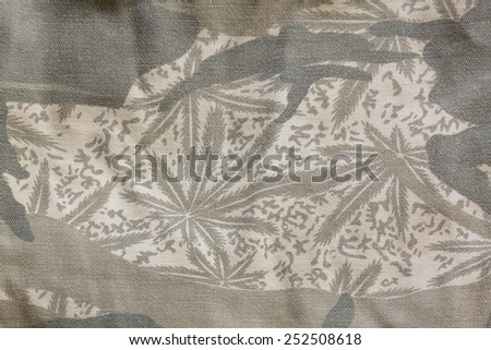 Close up old camouflage fabric texture background - stock photo