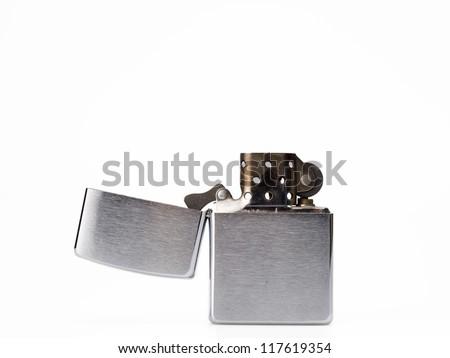 Close up old fashioned vintage zippo isolated on white background - stock photo