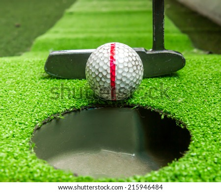 Close up, Old golf balls and putter on artificial grass for practice. - stock photo