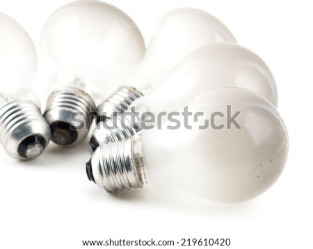 Close up Old light bulb isolated on white - stock photo