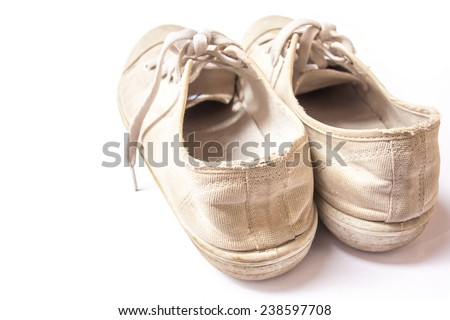 close up old sneakers on white background. - stock photo