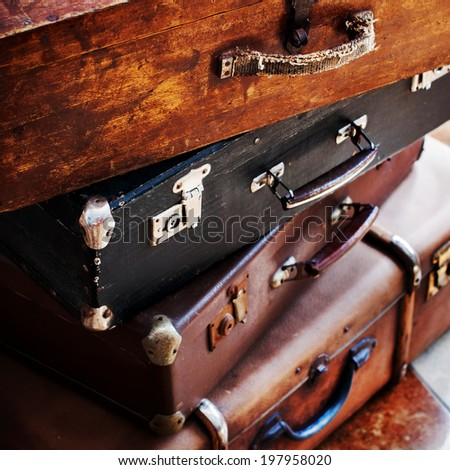 Close up Old Vintage Handles and Locks on an Antique Trunks in a Stack, Toned Picture - stock photo