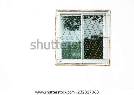 close up old window and white wall in house