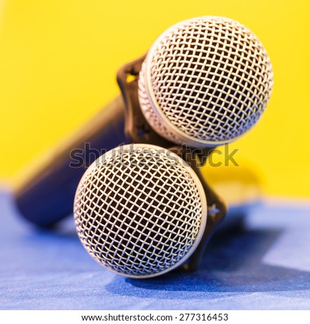 Close up old wireless microphone in conference room, education concept