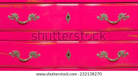 close-up, old wooden furniture pink dresser drawers to store items and securities - stock photo