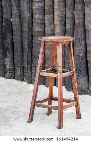 Close up Old wooden stool chair for beach bar  - stock photo