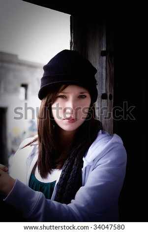 Close up on a Beautiful Teenager Sitting on an Old Abandoned Train