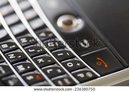 Close up on a black smartphone with keypad - stock photo