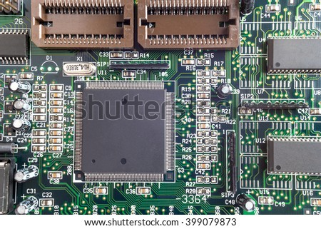 Close-up on a CPU microchip on a scheme in mainboard is heart important computer or electronic circuits. Silicone crystall.