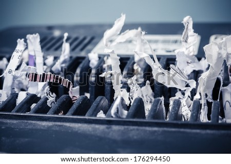 Close up on a cross shredder with paper - stock photo