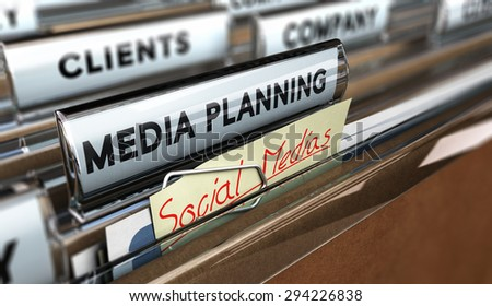 Close up on a file tab with the text media planning plus a note where it is handwritten social medias Blur effect. Concept image for illustration of communication or advertising agency - stock photo