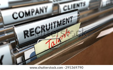 Close up on a file tab with the text recruitment plus a note where it is handwritten talents. Blur effect. Concept image for illustration of head hunter. - stock photo
