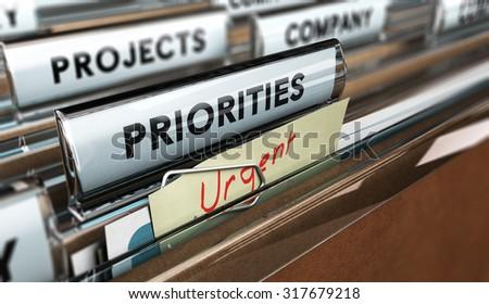 Close up on a file tab with the word Priorities with blur effect. Concept image for illustration of setting priorities in projects. - stock photo