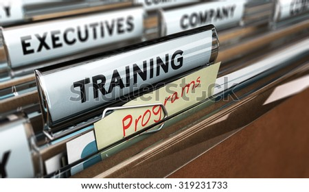 Close up on a file tab with the word training, focus on a yellow, note where it is handwritten program, blur effect. Concept image for illustration of employee, training