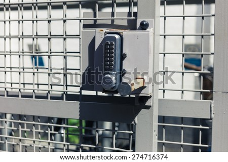 Close up on a keypad lock on a bicycle shed - stock photo