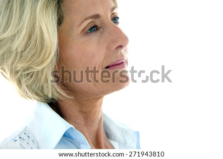 Close up on a mature woman looking away - white background with copy space - stock photo