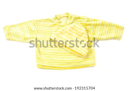 Close up on a newborn baby yellow blouse and hat with stripes - stock photo