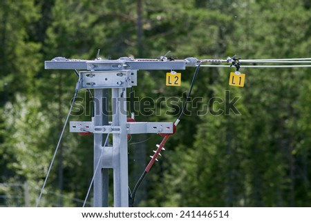 Close-up on a overhead line for a railroad. Modern, newly built High-speed railway straight through rural countryside.  - stock photo