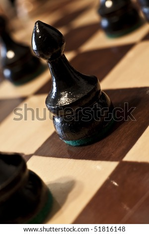 Close up on a pawn on a chess board.