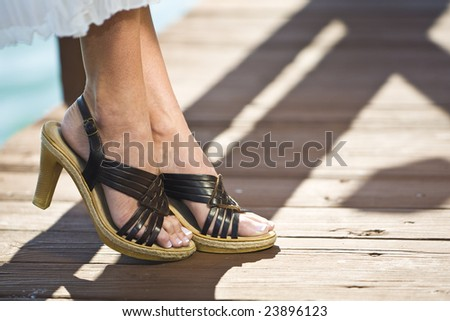 Close up on a perfect pair of female feet - stock photo