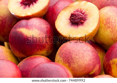 Close up on a pile of peaches. - stock photo