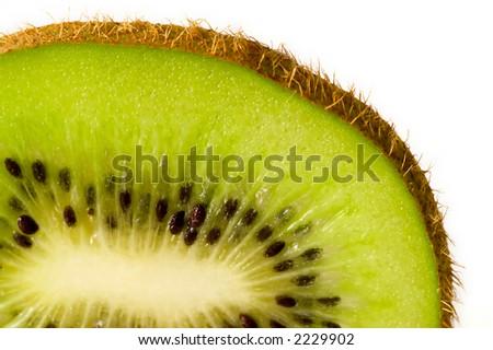 Close up on a single kiwi fruit slice - stock photo