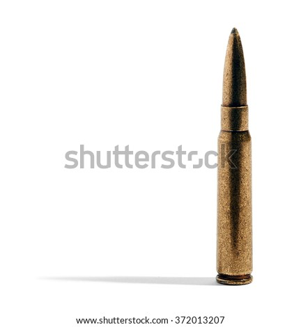 Close up on a single rifle bullet in a brass casing casting a lateral shadow over a white background with copy space