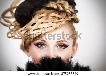 Close up on a woman`s beautiful eyes. Beauty girl portrait with vivid makeup and fan - stock photo
