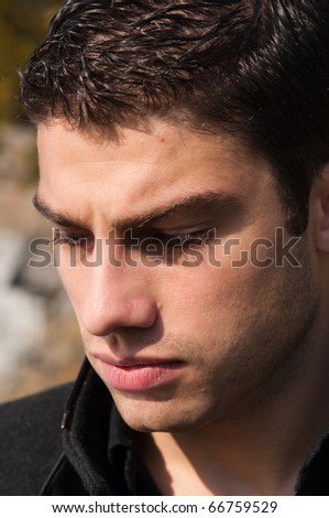 close up on a young depressed man - stock photo