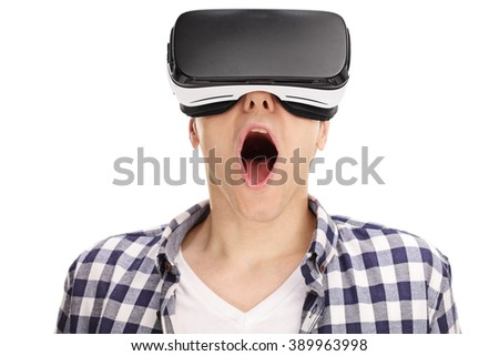 Close-up on an amazed young guy using a VR headset and experiencing virtual reality isolated on white background - stock photo