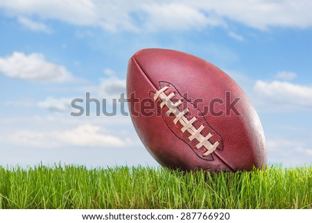 Close-up on an American football on a field outdoors - stock photo