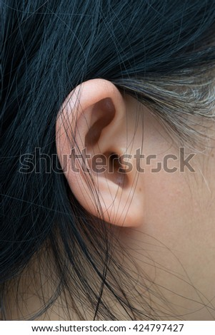 Close up on an ear of an asian person