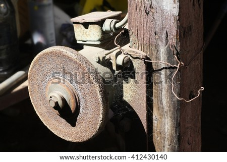 Close up on an old electrical grinder - stock photo
