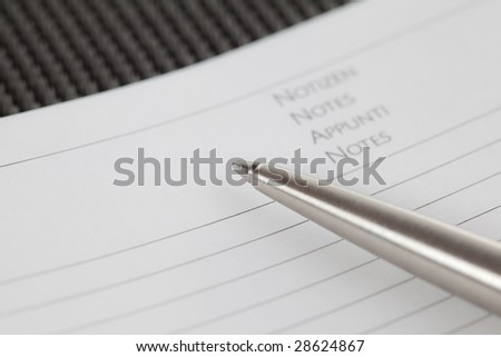Close-up on an open agenda. Blank page. Shallow depth of field.