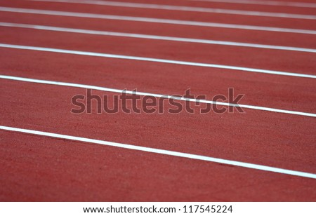 Close up on athletics track - stock photo