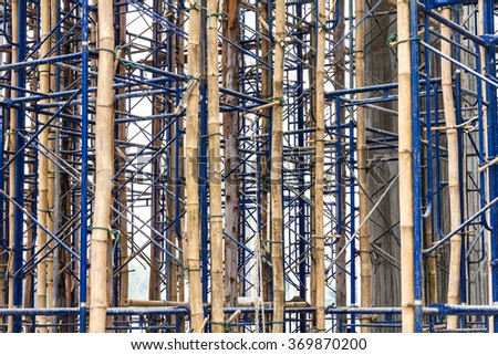 Close up on bamboo scaffolding steel, which is currently serving temporary bracing in construction.