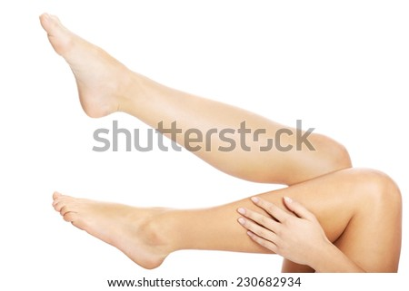Close up on beautiful female nude legs.
