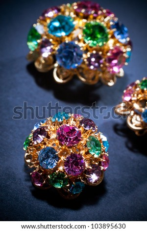 Close-up on colourful jewel-like buttons. - stock photo