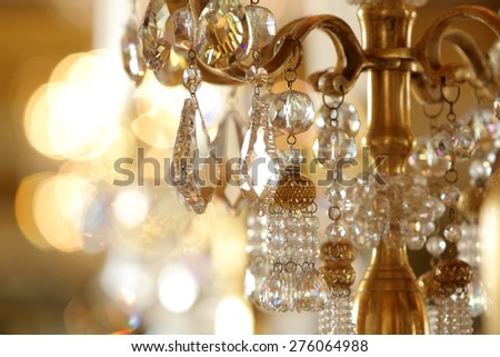 Close up on crystal of contemporary chandelier - stock photo